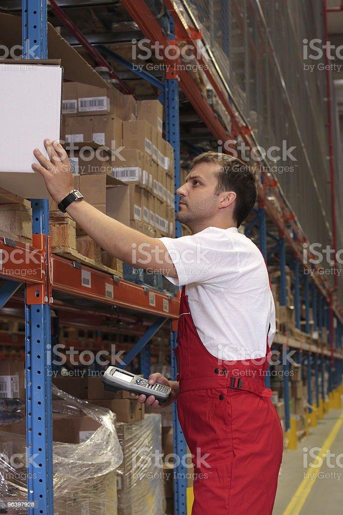 worker maintaining stocks royalty-free stock photo