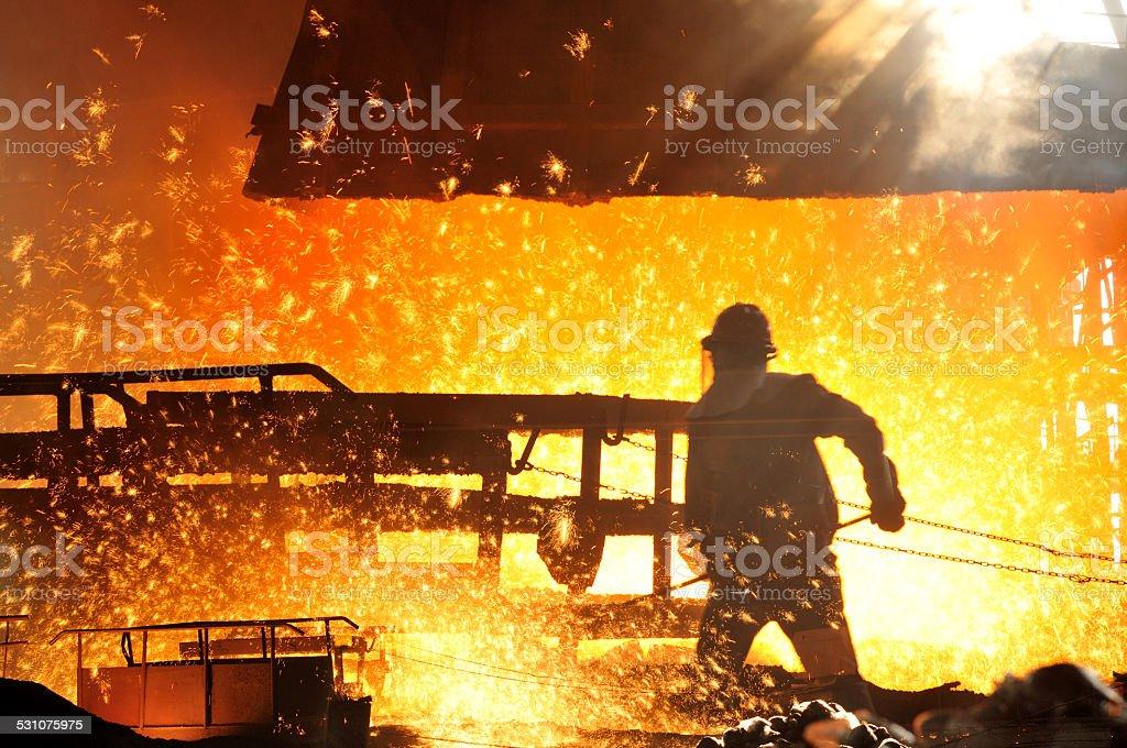Worker making iron water stock photo
