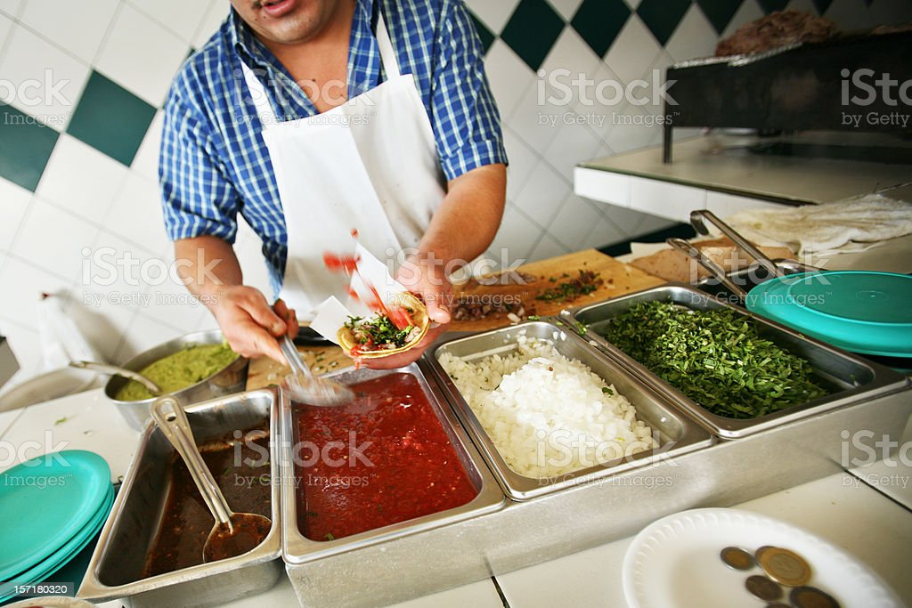 Worker Making Tacos at a Restaurant royalty-free stock photo