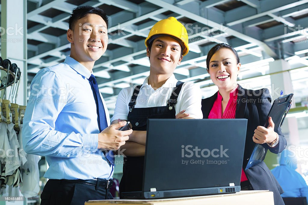 A worker, manager and owner of a factory smiling stock photo