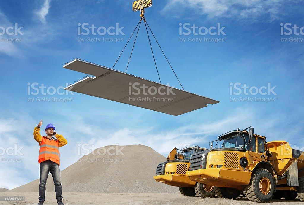 Worker managing transportation of concrete panel stock photo
