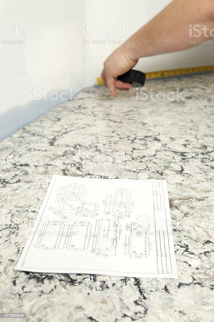 Worker Measuring Countertop for Backsplash Installation royalty-free stock photo