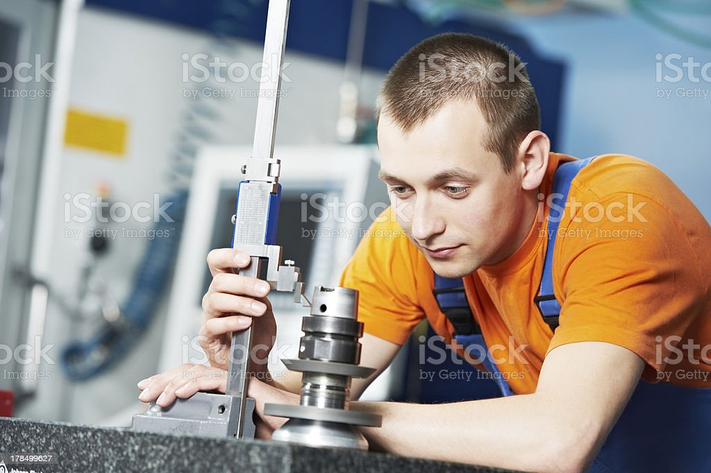 worker measuring cutting tool royalty-free stock photo