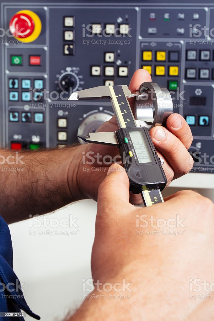 Worker measuring detail stock photo