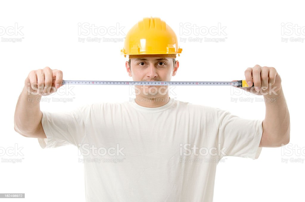 Worker measuring, looking at the camera royalty-free stock photo