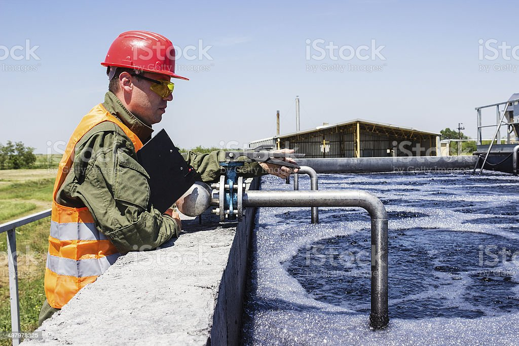 Worker monitor filtering water stock photo