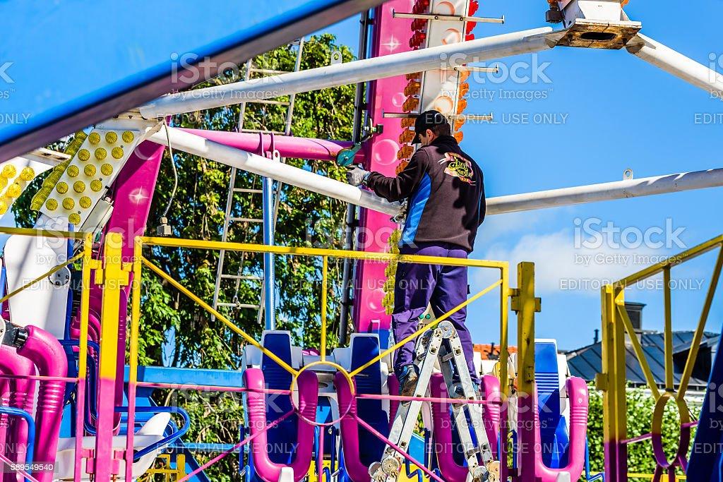 Worker mount an amusement ride stock photo