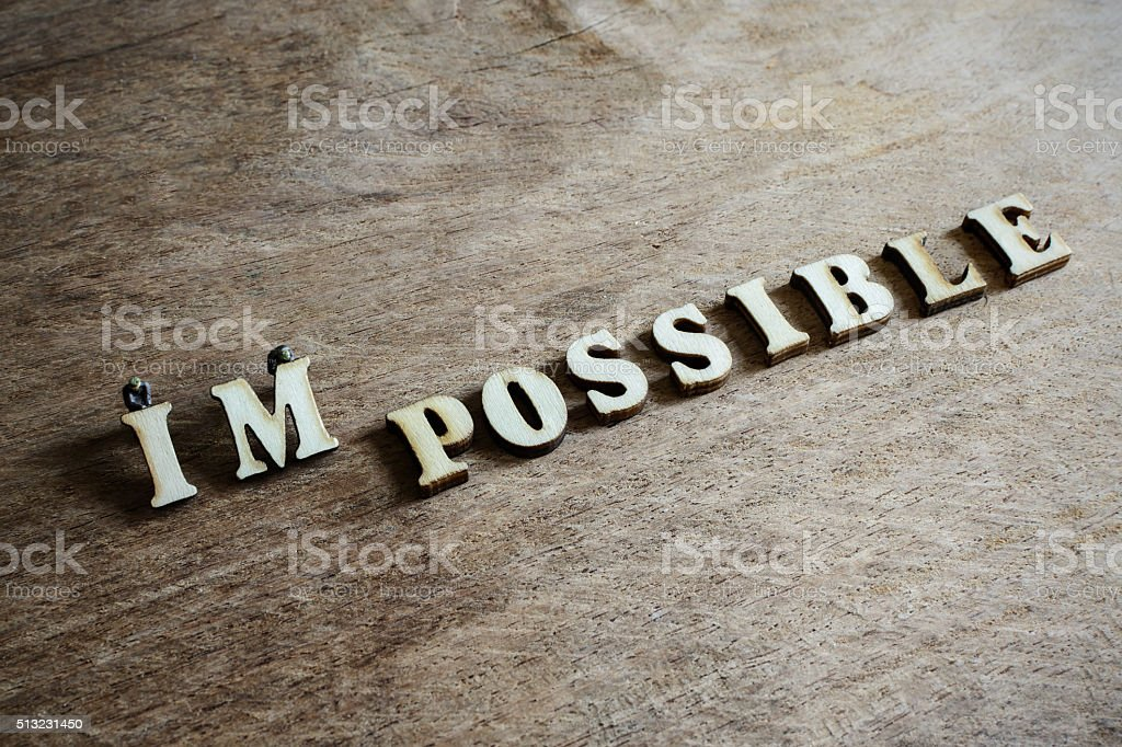 Worker moving on the word impossible to make possible stock photo