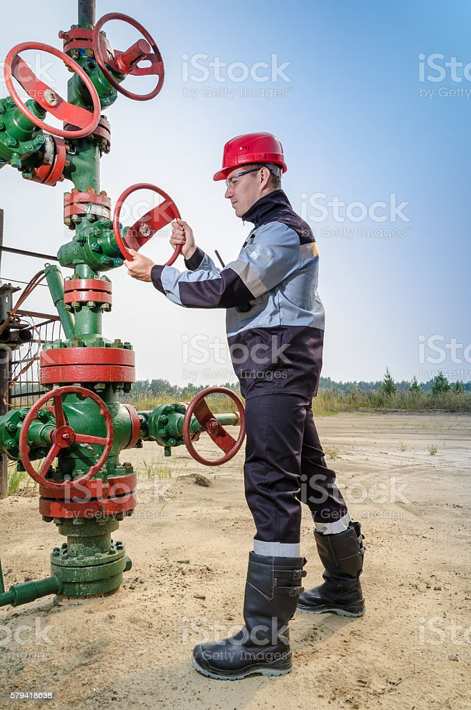 Worker near wellhead stock photo