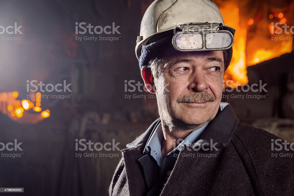 Worker of a metallurgical factory stock photo