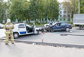 Worker of Ministry of Emergency Situations (rescuer) at traffic accident