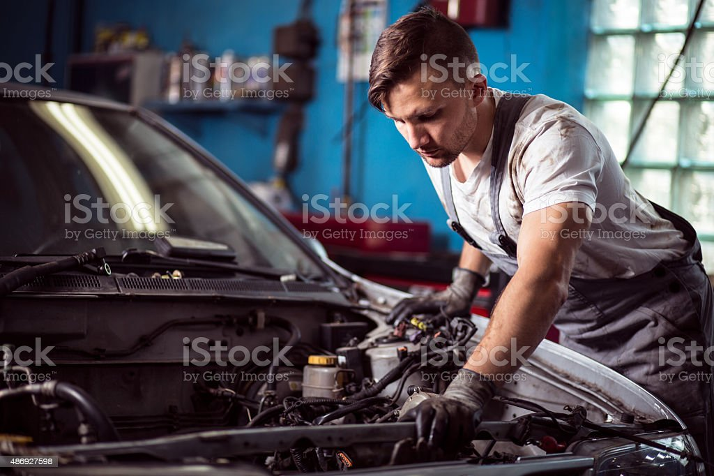 Worker of service station repairing stock photo