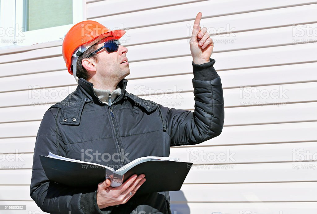 Worker on a construction site in winter stock photo