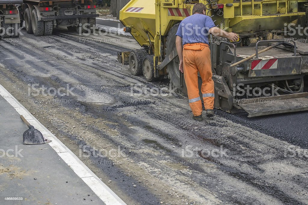Worker on a road construction stock photo