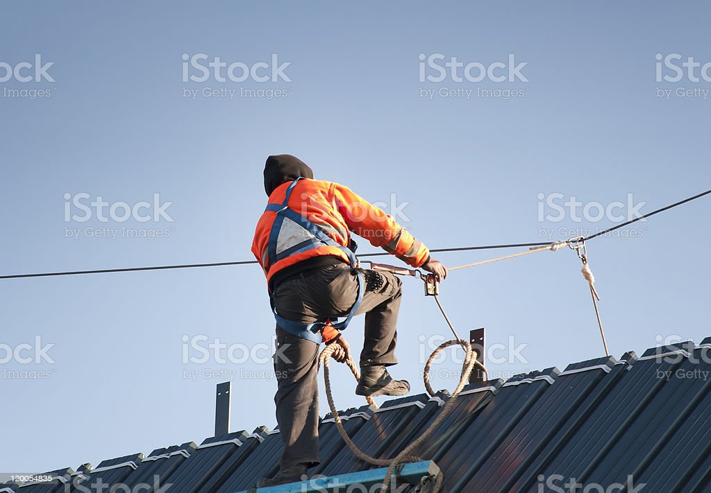 Worker on a roof stock photo