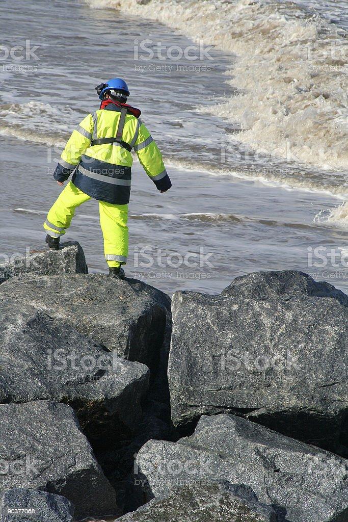 Worker on beach defenses stock photo
