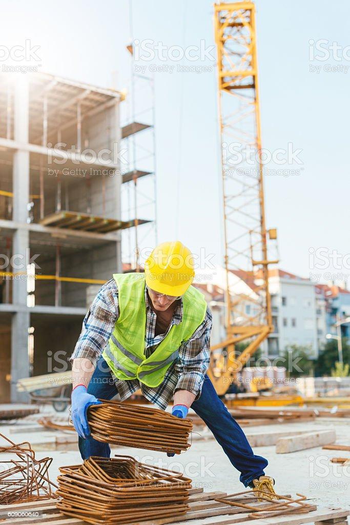 Worker on construction platform near crane stock photo