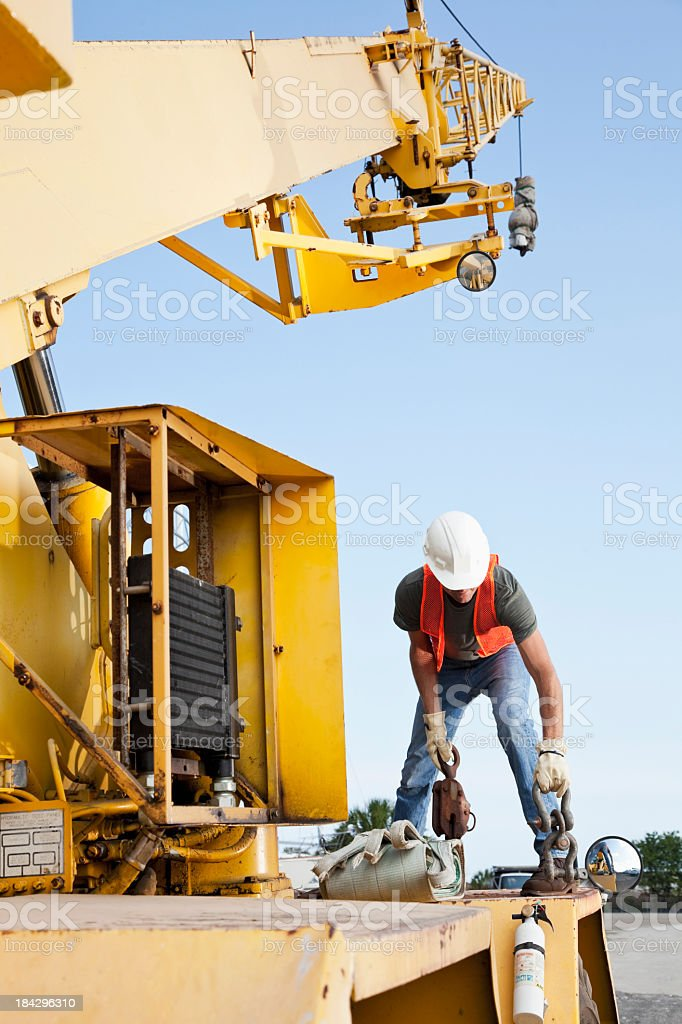 Worker on crane stock photo