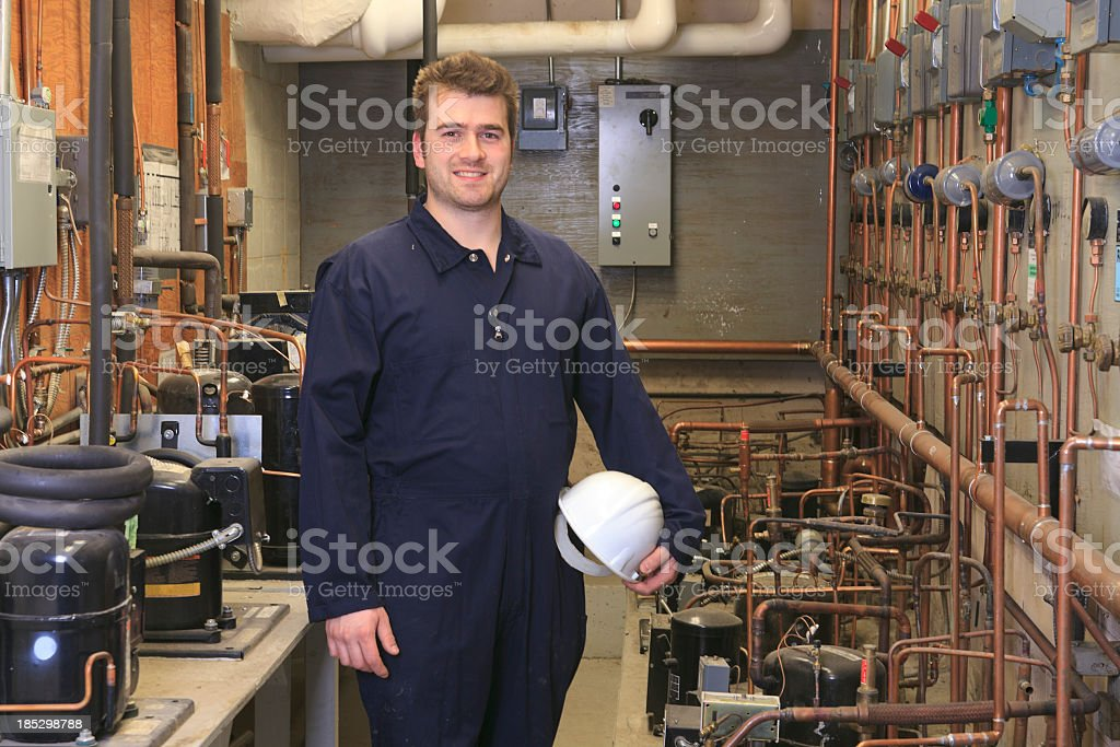 Worker on Fridge Compressor Room royalty-free stock photo