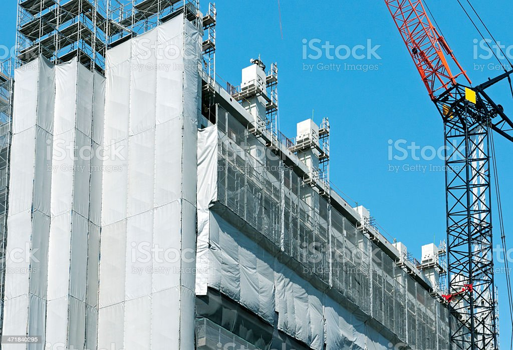 Worker on scaffolding at construction site in Osaka royalty-free stock photo