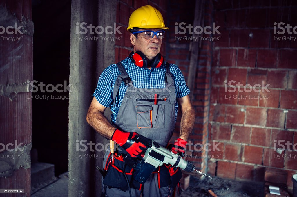 Worker on the building site stock photo
