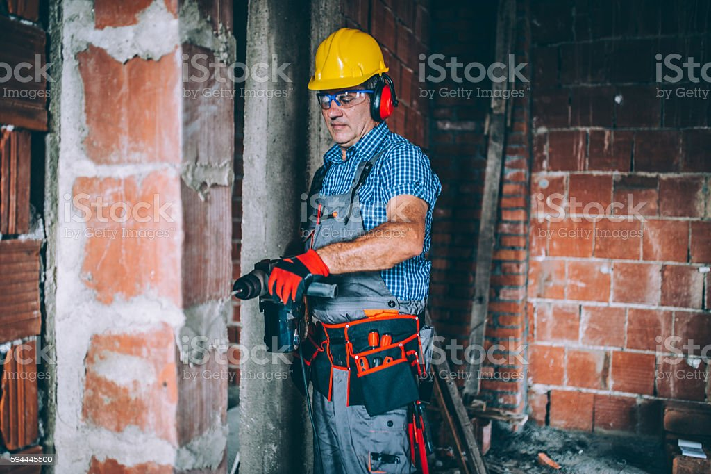 Worker on the construction site site stock photo