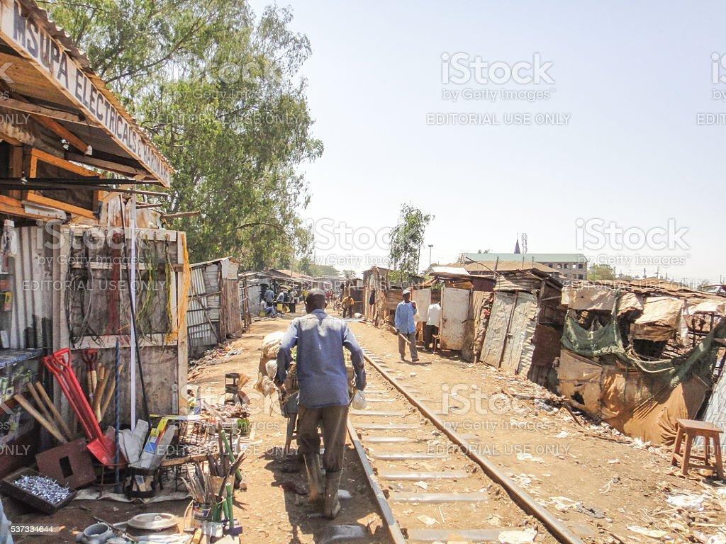 Worker on the street of Kibera slum stock photo
