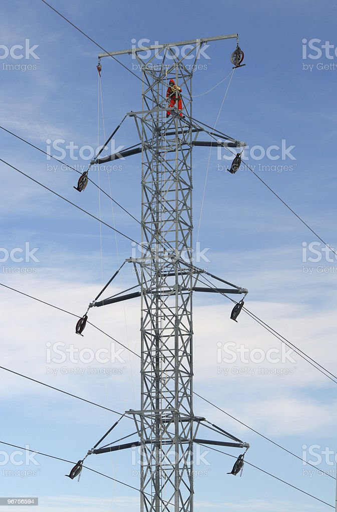 Worker on top of hydro tower stock photo