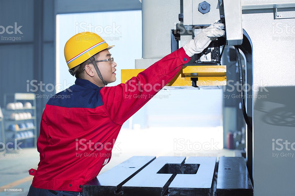 Worker operating Automated Tooling stock photo