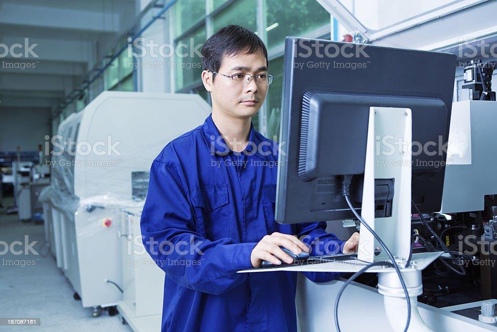 worker operating CNC machine center - Stock Image stock photo