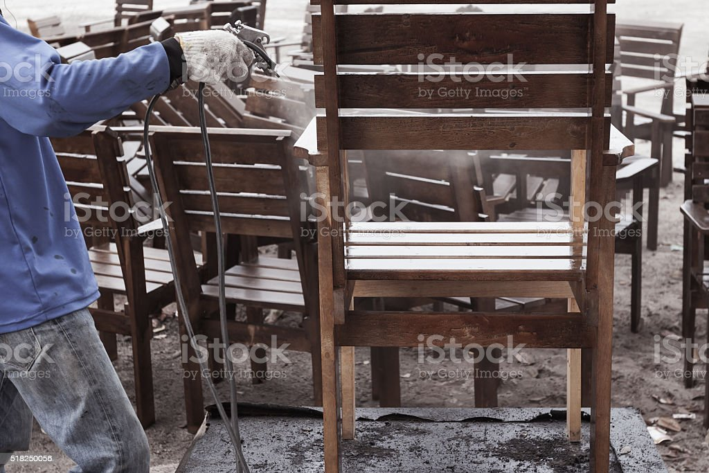 worker or carpenter, hand splash painted or repair, wooden chair stock photo