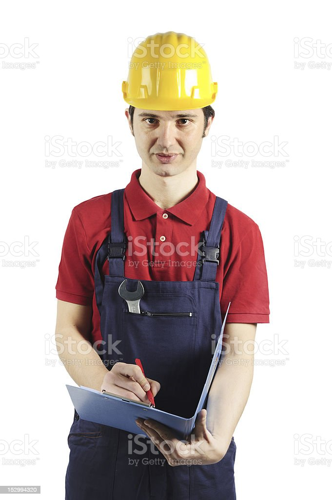 Worker overall with clipboard in his hand royalty-free stock photo