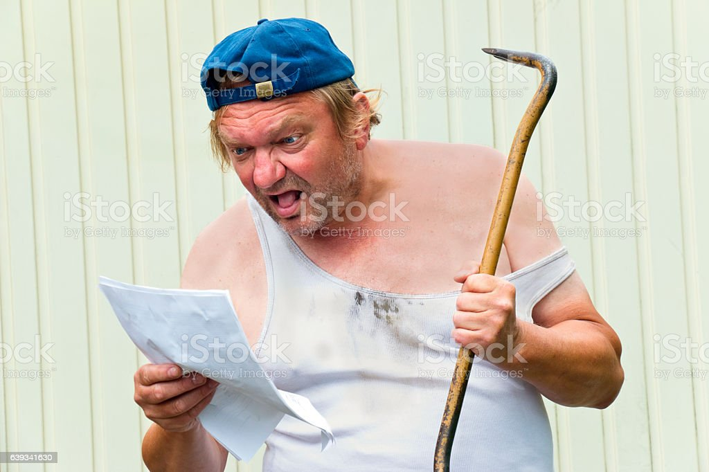 Worker overwhelmed by instruction manual stock photo