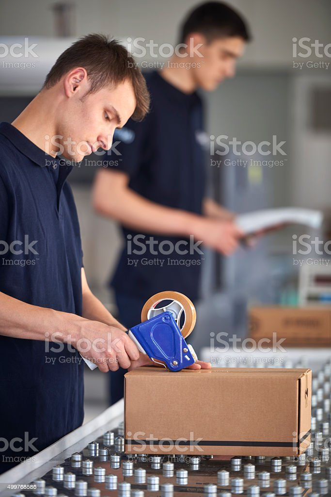 Worker packing box in warehouse stock photo