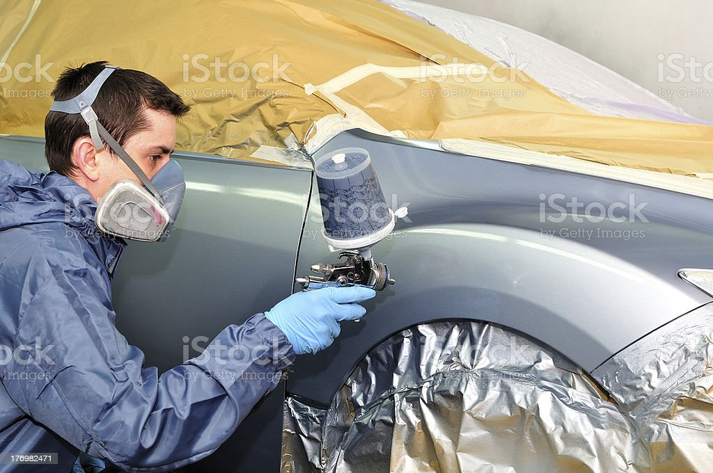 Worker painting a car. stock photo
