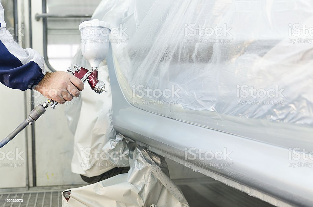 Worker painting a car stock photo