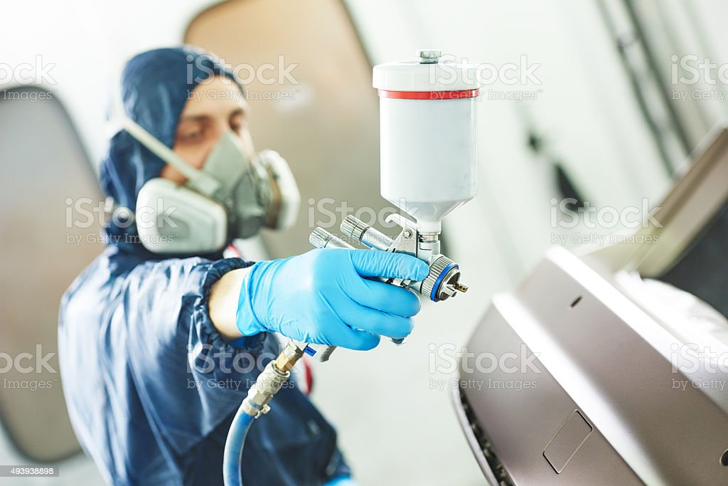 worker painting auto car bumper stock photo