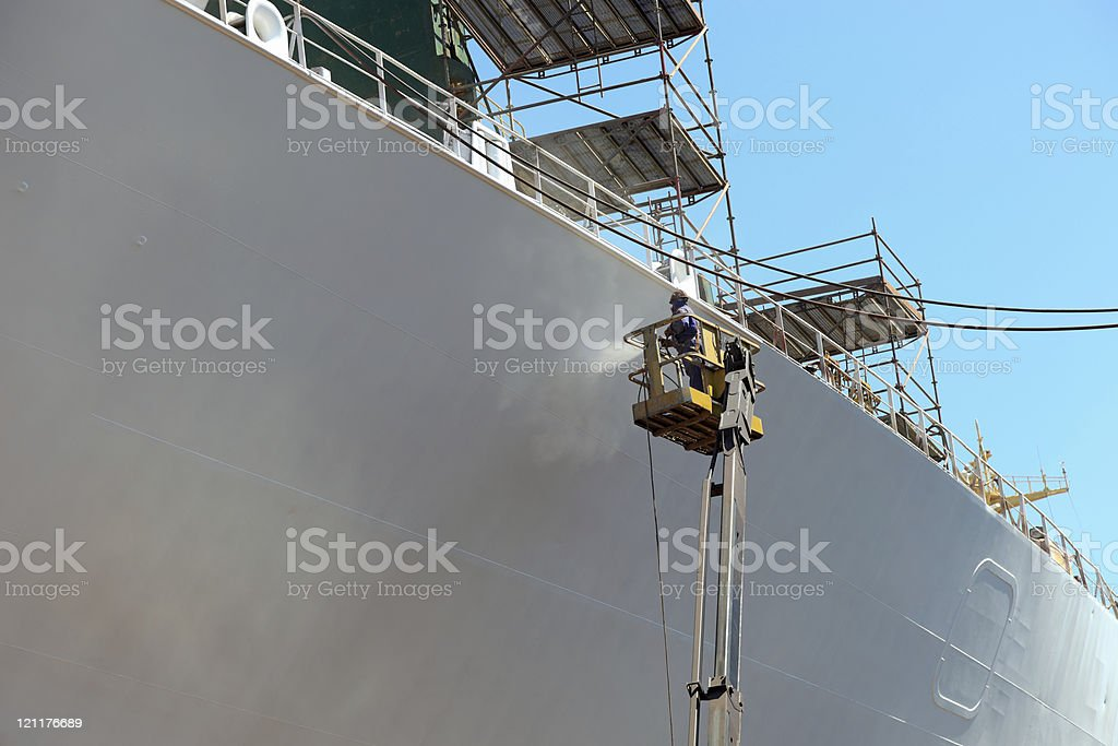 Worker painting of the ship stock photo