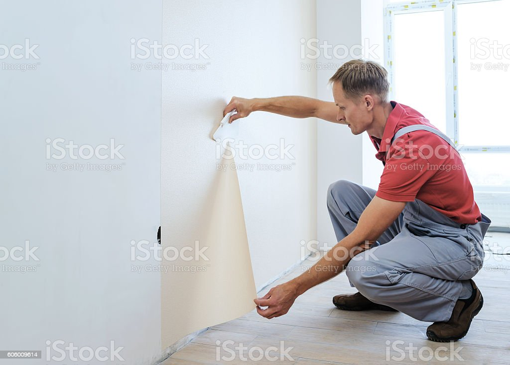 Worker pasting wallpapers. stock photo