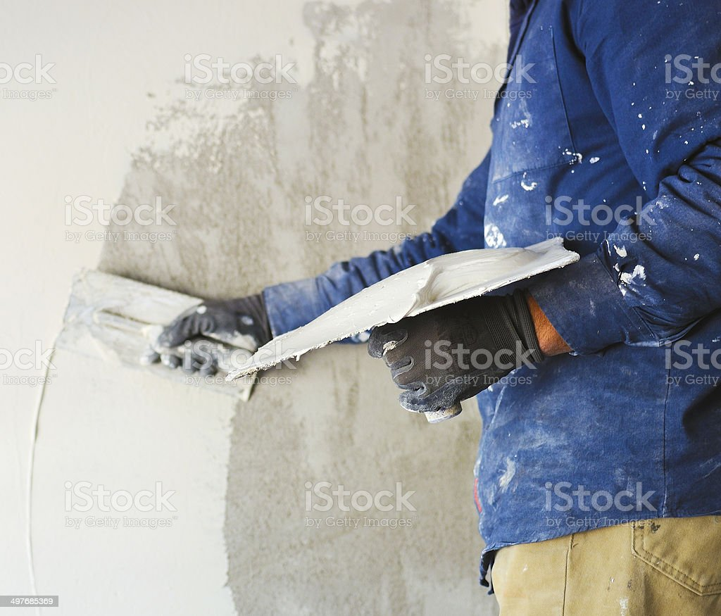 worker plastering tool plaster marble on interior plaster rough stock photo