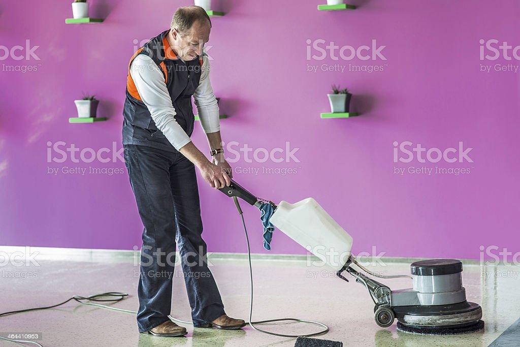 Worker Polishing the Floor with Machine stock photo