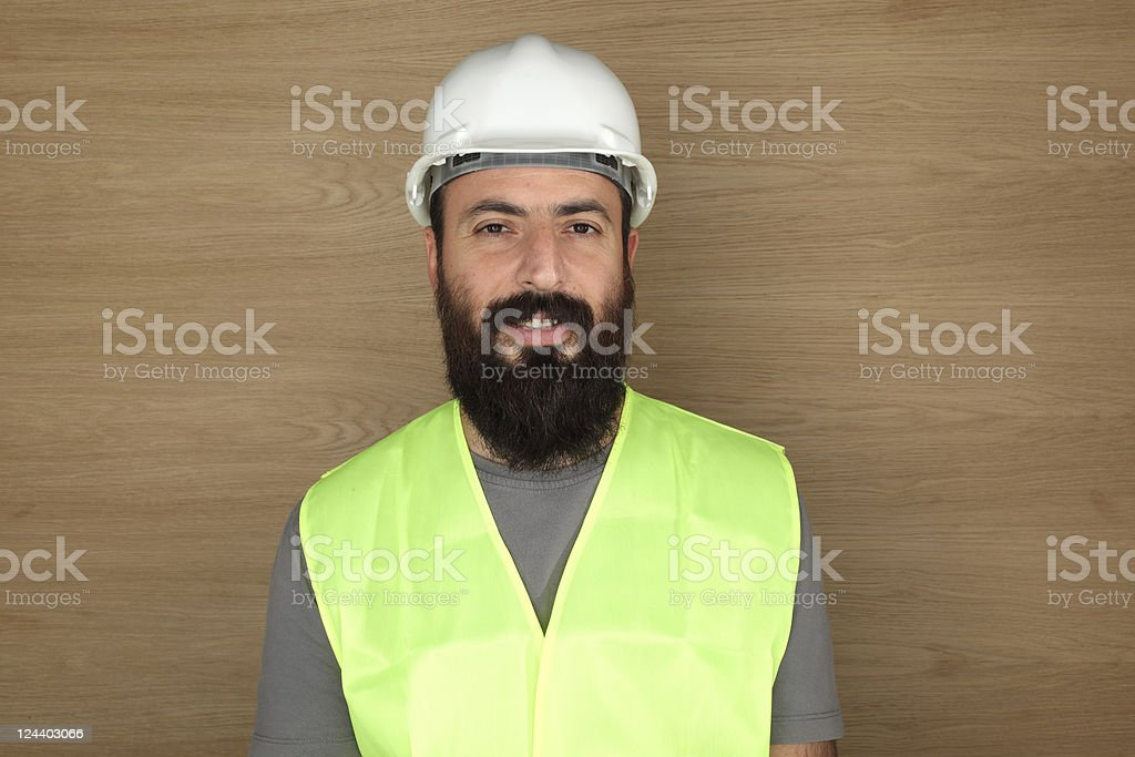 Worker portrait over wood background royalty-free stock photo