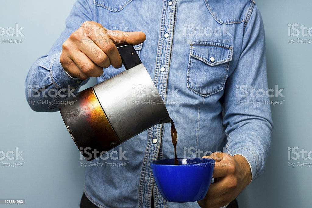 Worker pouring coffee from moka pot stock photo