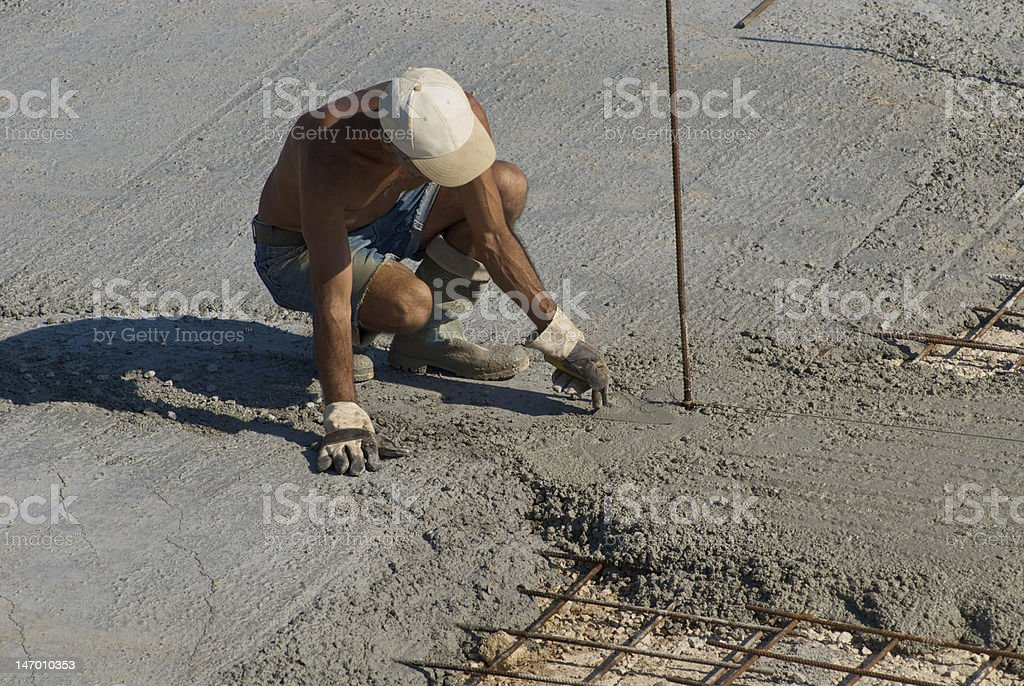 worker pouring concrete royalty-free stock photo