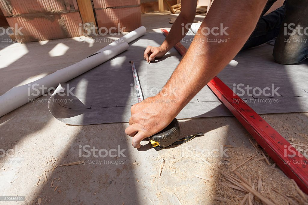 Worker prepare to cut the vapor barrier stock photo