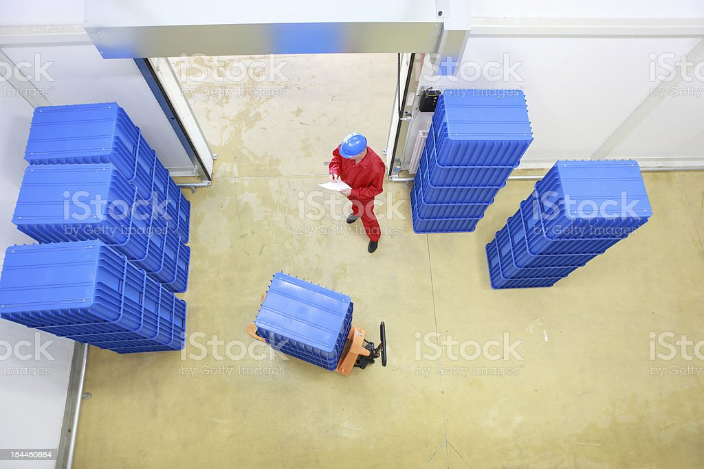 worker preparing goods delivery in a small company warehouse royalty-free stock photo