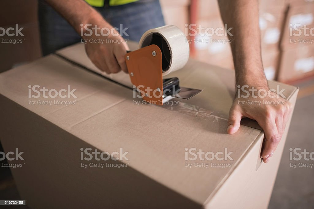 Worker preparing goods for dispatch stock photo