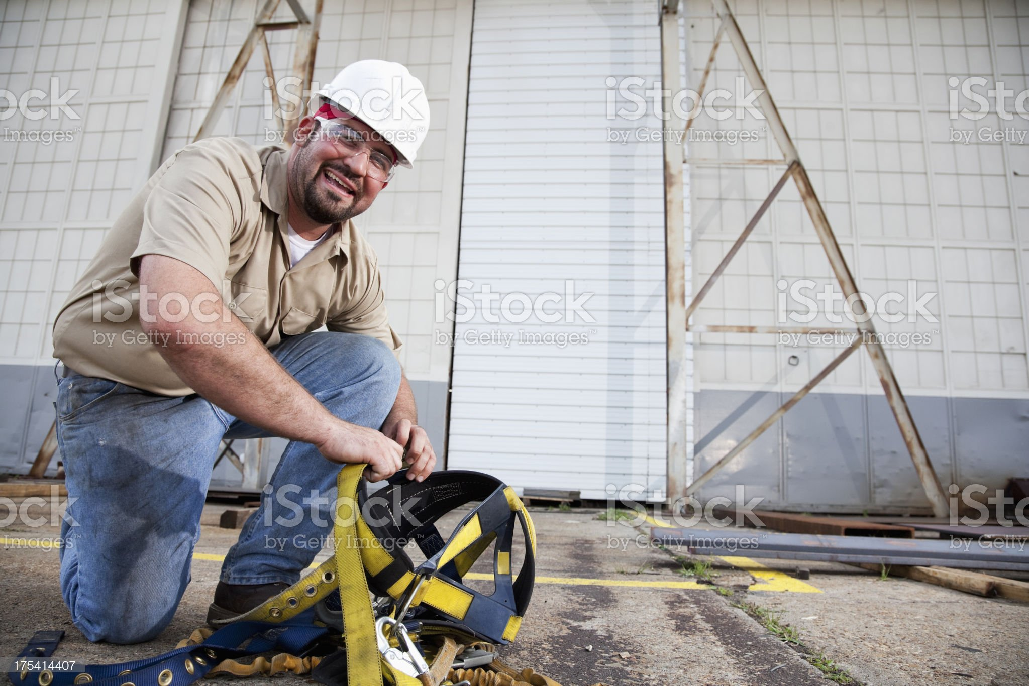 Worker preparing safety harness royalty-free stock photo