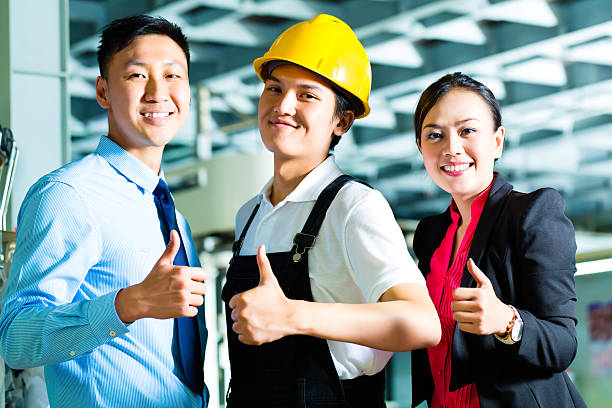 worker production manager and owner in factory stock photo - Fashion Production Manager