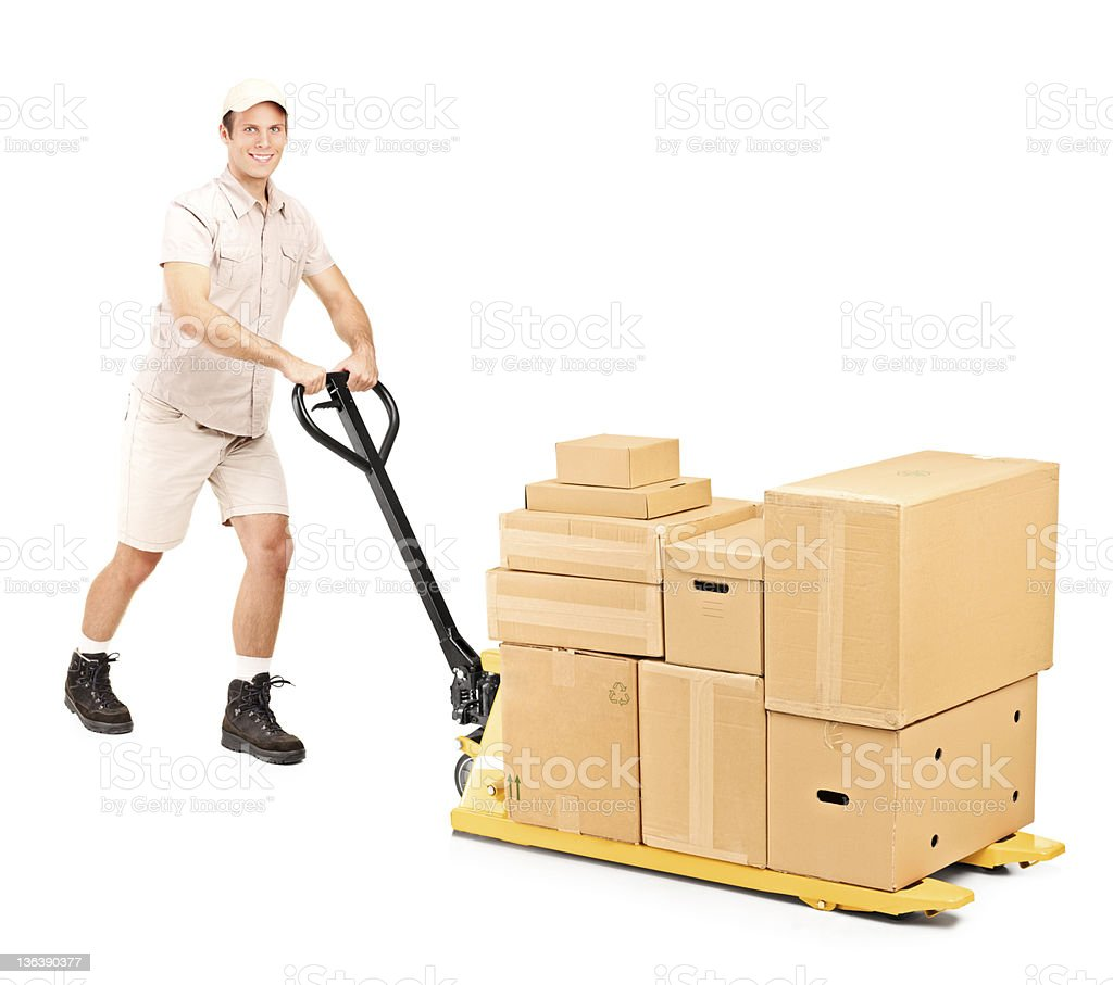 Worker pushing a fork pallet truck stock photo